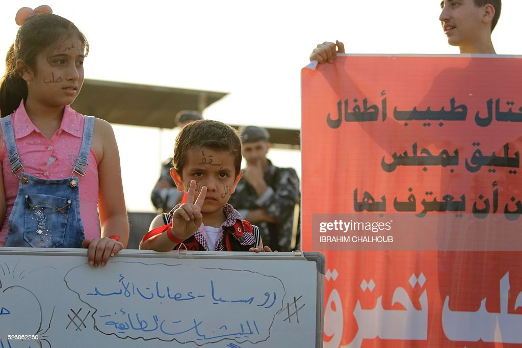 Syrian children take part in a rally in solidarity with Aleppo, in the Lebanese northern port city of Tripoli, on May 1, 2016. More than a week of fighting in Syria's second city has killed hundreds of civilians and left a UN-backed peace process hanging by a thread. Concern has been growing that the fighting in Aleppo will lead to the complete collapse of a landmark ceasefire between President Bashar al-Assad's regime and non-jihadist rebels that was brokered by Moscow and Washington. / AFP / IBRAHIM