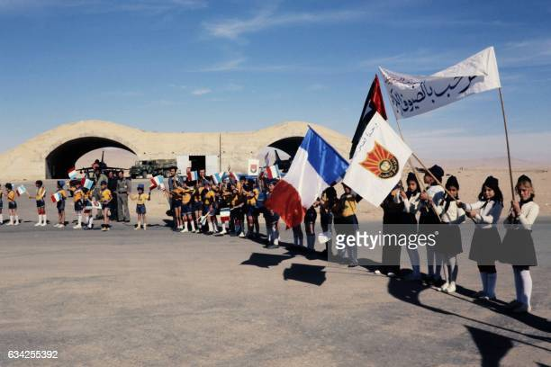 Syrian children welcome French Prime Minister Raymond Barre at the Palmyra airport on NOvember 28 1977 during Barre's official visit to Damascus /...