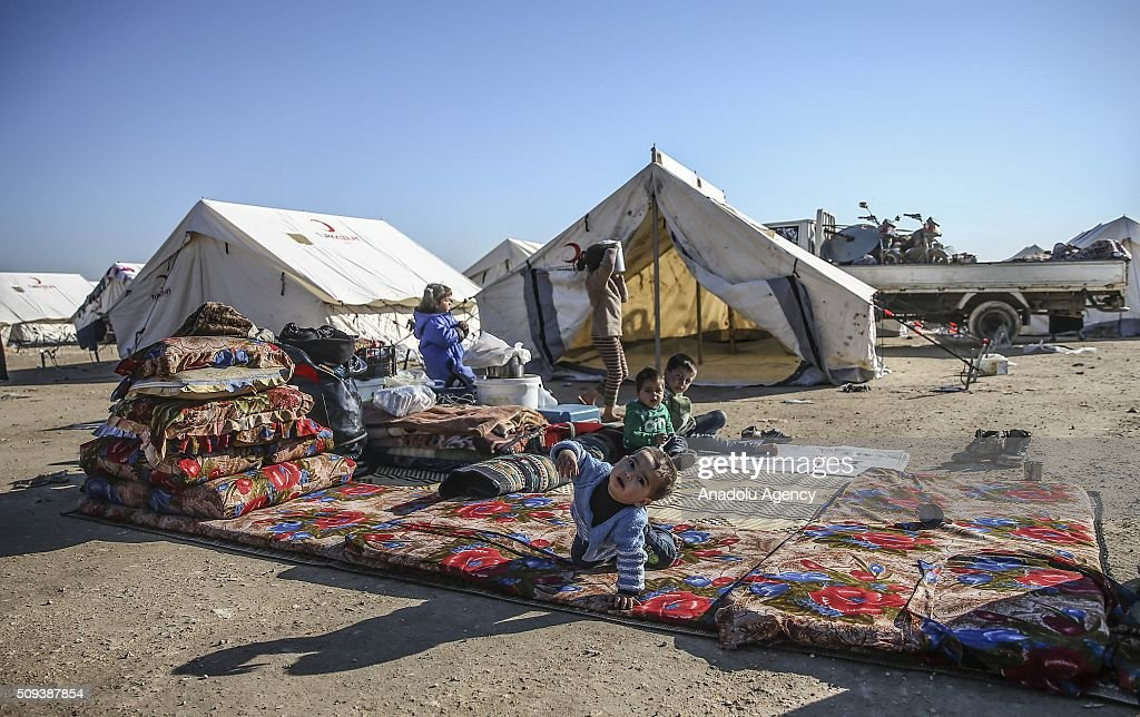 Syrian children, who fled bombing in Aleppo, are seen at a tent city and close to the Bab al-Salam border crossing on Turkish-Syrian border near Azaz town of Aleppo, Syria on February 10, 2016. Russian airstrikes have recently forced some 40,000 people to flee their homes in Syrias northern city of Aleppo.