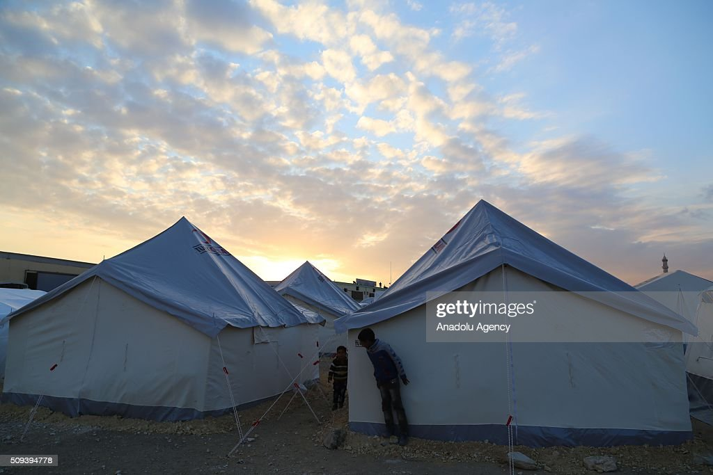 Syrian children, who fled bombing in Aleppo, are seen at a tent city close to the Bab al-Salam border crossing on Turkish-Syrian border near Azaz town of Aleppo, Syria on February 10, 2016. Russian airstrikes have recently forced some 40,000 people to flee their homes in Syrias northern city of Aleppo.