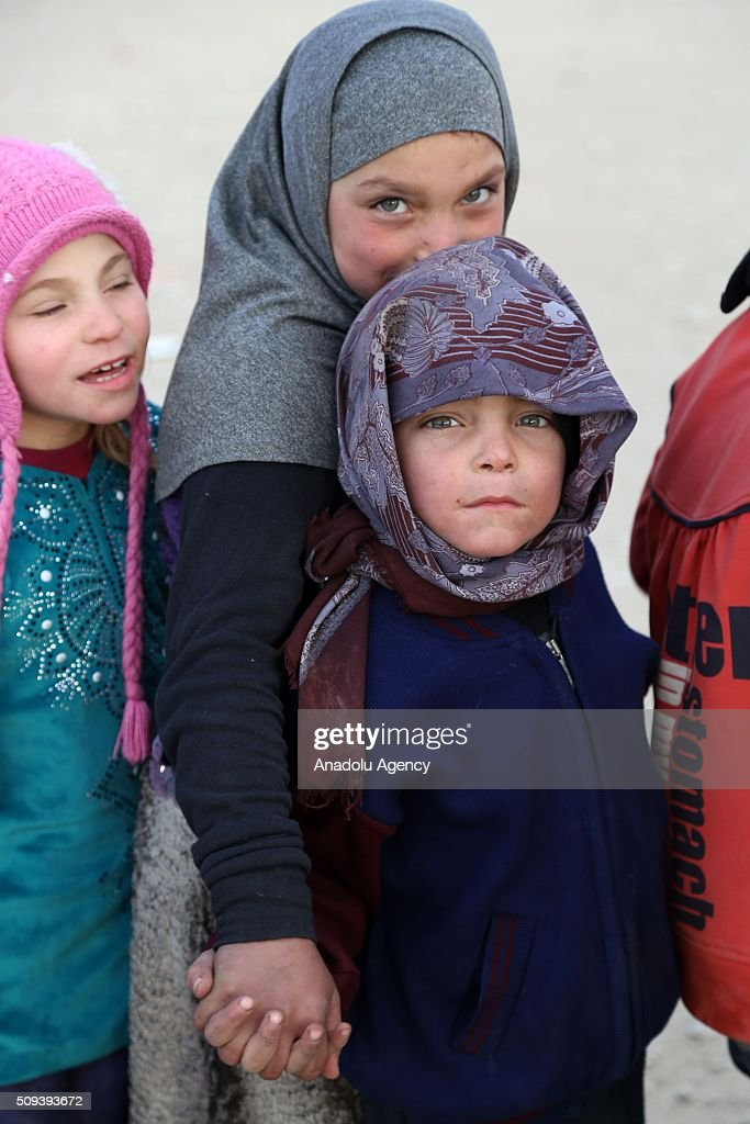 Syrian children, who fled bombing in Aleppo, wait in a queue to get food at a tent city close to the Bab al-Salam border crossing on Turkish-Syrian border near Azaz town of Aleppo, Syria on February 10, 2016. Russian airstrikes have recently forced some 40,000 people to flee their homes in Syrias northern city of Aleppo.