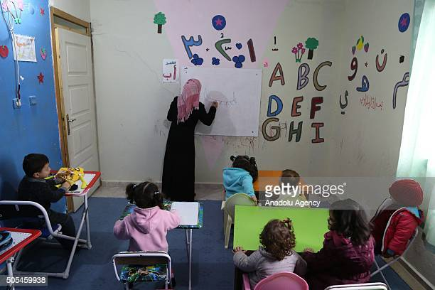 Syrian children who fled their country because of the ongoing civil war are seen at a nursery school for refugee children in Hatay Turkey on January...