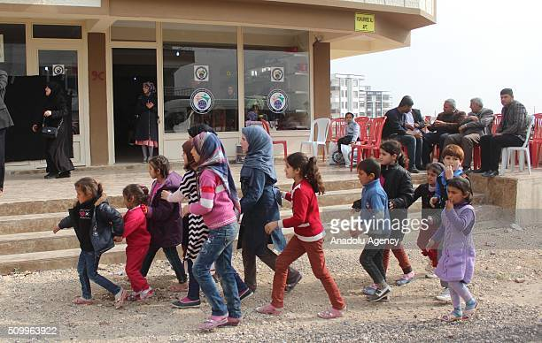 Syrian children who have lost their mothers or fathers in the country's civil war are seen outside a shop after the Sanliurfa Humanitarian Aid...