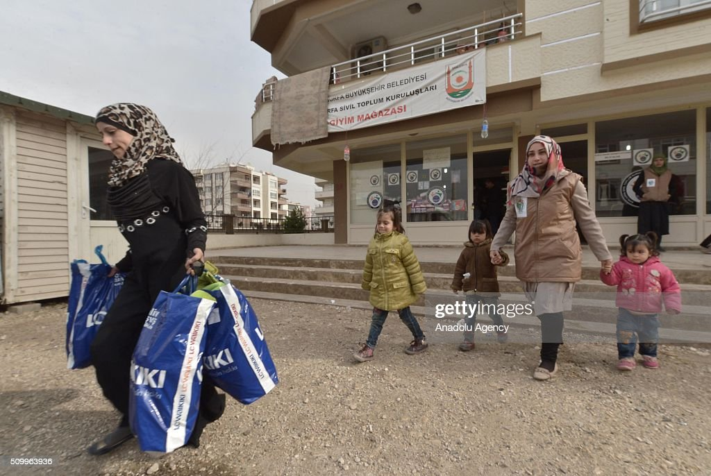 Syrian children, who have lost their mothers or fathers in the country's civil war, are seen outside a shop after the Sanliurfa Humanitarian Aid Platform provided clothes and toys to them in Sanliurfa, Turkey on February 13, 2016. The platform, which was established to carry out activities to help Syrian children, gave joy to children who had lost their parents in the Suleiman Shah camp. 115 children were brought to the Sanliurfa Humanitarian Aid Platform Charity Shop by minibuses to choose clothes for themselves.