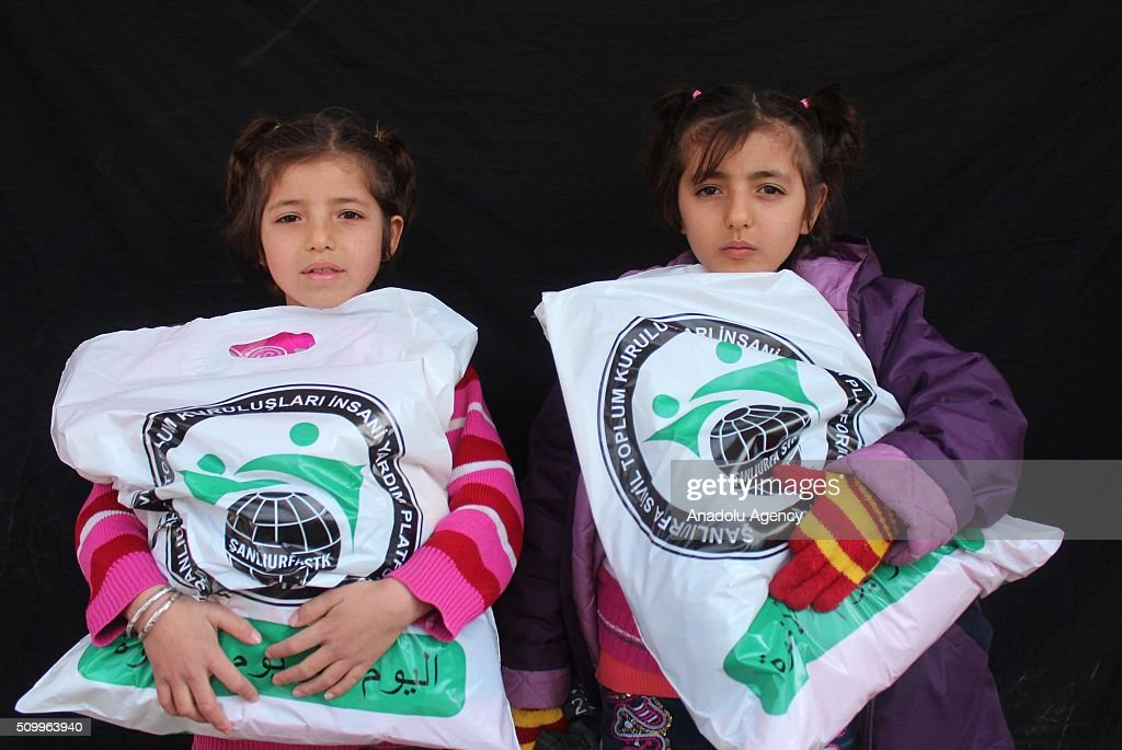 Syrian children, who have lost their mothers or fathers in the country's civil war, are seen after the Sanliurfa Humanitarian Aid Platform provided clothes and toys to them in Sanliurfa, Turkey on February 13, 2016. The platform, which was established to carry out activities to help Syrian children, gave joy to children who had lost their parents in the Suleiman Shah camp. 115 children were brought to the Sanliurfa Humanitarian Aid Platform Charity Shop by minibuses to choose clothes for themselves.