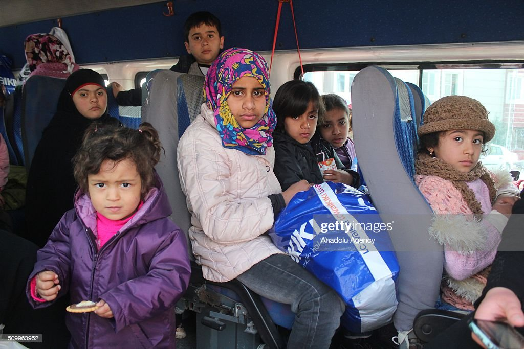 Syrian children, who have lost their mothers or fathers in the country's civil war, are seen in a bus after the Sanliurfa Humanitarian Aid Platform provided clothes and toys to them in Sanliurfa, Turkey on February 13, 2016. The platform, which was established to carry out activities to help Syrian children, gave joy to children who had lost their parents in the Suleiman Shah camp. 115 children were brought to the Sanliurfa Humanitarian Aid Platform Charity Shop by minibuses to choose clothes for themselves.