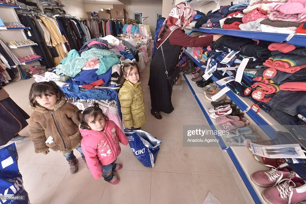 Syrian children, who have lost their mothers or fathers in the country's civil war, are seen in a shop after the Sanliurfa Humanitarian Aid Platform provided clothes and toys to them in Sanliurfa, Turkey on February 13, 2016. The platform, which was established to carry out activities to help Syrian children, gave joy to children who had lost their parents in the Suleiman Shah camp. 115 children were brought to the Sanliurfa Humanitarian Aid Platform Charity Shop by minibuses to choose clothes for themselves.