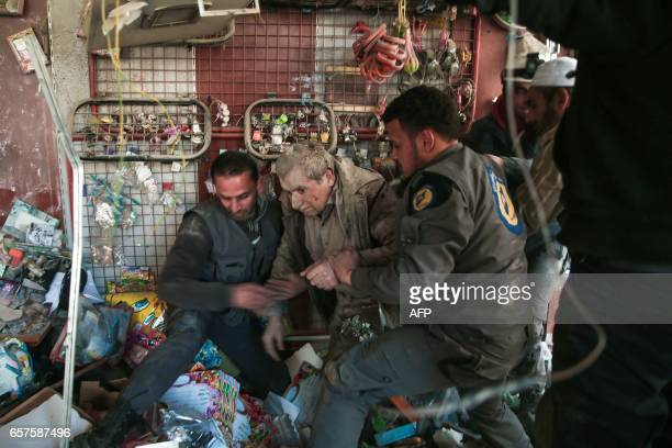 TOPSHOT CORRECTION Syrian civil defence volunteers known as the White Helmets rescue a survivor following reported airstrikes on the rebelheld town...