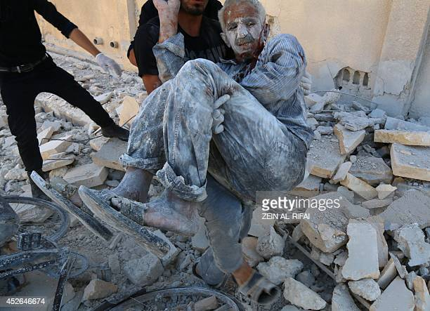Syrian civil defense workers rescue a man from under the rubble on July 25 after a Syrian government helicopter allegedly dropped a barrel bomb on...