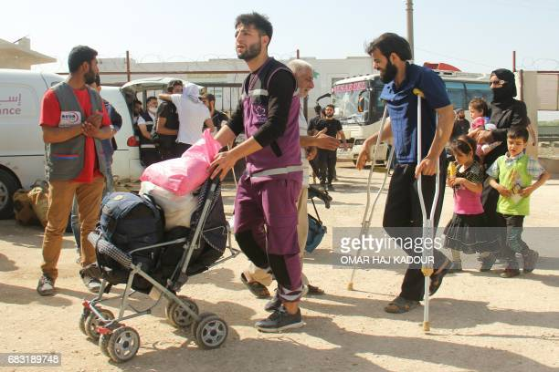 Syrian civilians and rebels who were evacuated from the Qabun district in northeast Damascus arrive at a temporary camp in the northern countryside...