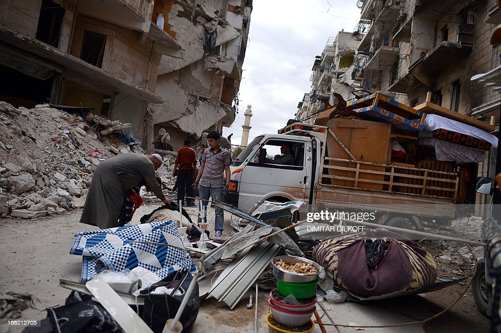 Syrian civilians collect what's left of their belongings from their damaged apartments before fleeing the northern Syrian city of Aleppo on April 10, 2013. The United States is mulling ways to step up support for the Syrian opposition, a top US official said, as US Secretary of State John Kerry and G8 ministers were to meet rebel leaders.