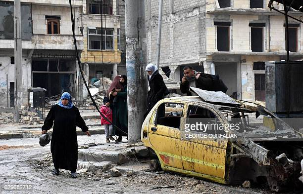 Syrian civilians from the alSukari neighbourhood flee during the ongoing government forces military operation to retake remaining rebelheld areas in...