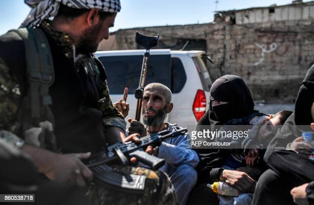 Syrian civilians gather on the western front after fleeing the centre of Raqa on October 12 2017 Syrian Democratic Forces Syrian fighters backed by...