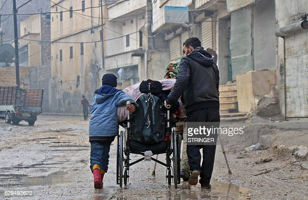 Syrian civilians leave towards safer rebelheld areas in Aleppo on December 13 during an operation by Syrian government forces to retake the embattled...