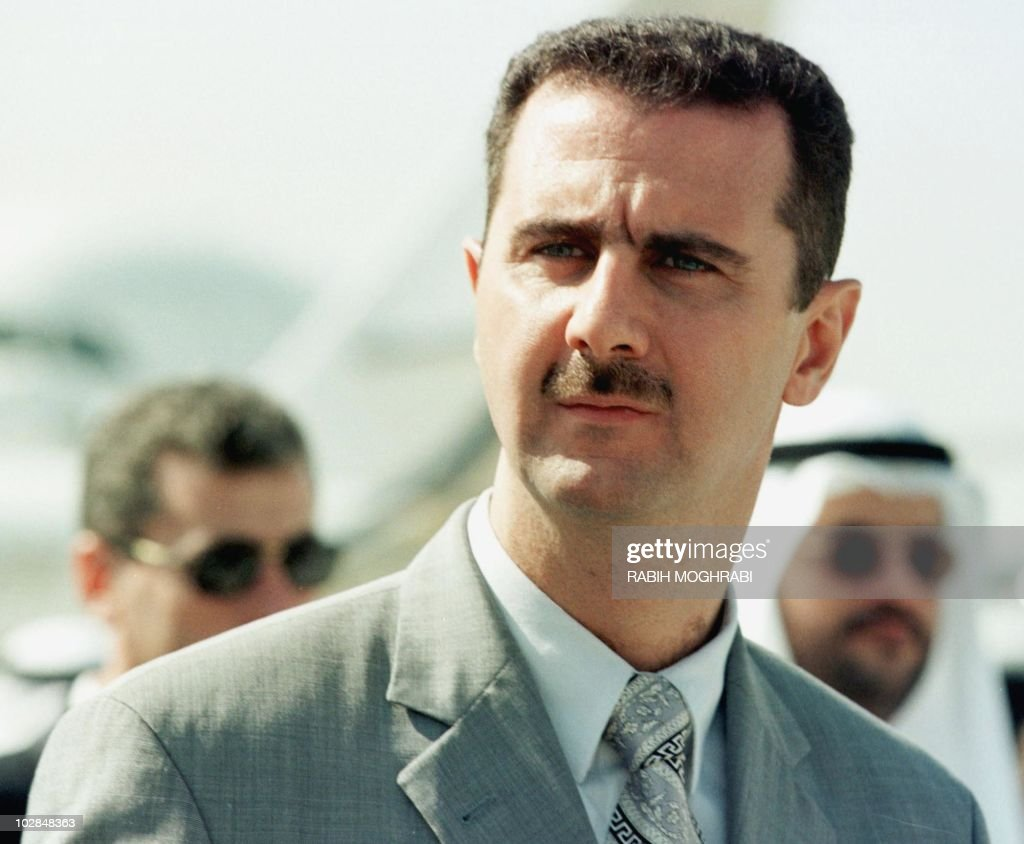 Syrian Colonel <a gi-track='captionPersonalityLinkClicked' href=/galleries/search?phrase=Bashar+al-Assad&family=editorial&specificpeople=206274 ng-click='$event.stopPropagation()'>Bashar al-Assad</a> attends the opening of the Dubai air show, 14 November 1999. Assad, 34, is being groomed to take over from his 69-year-old father, President Hafez al-Assad, analysts say.