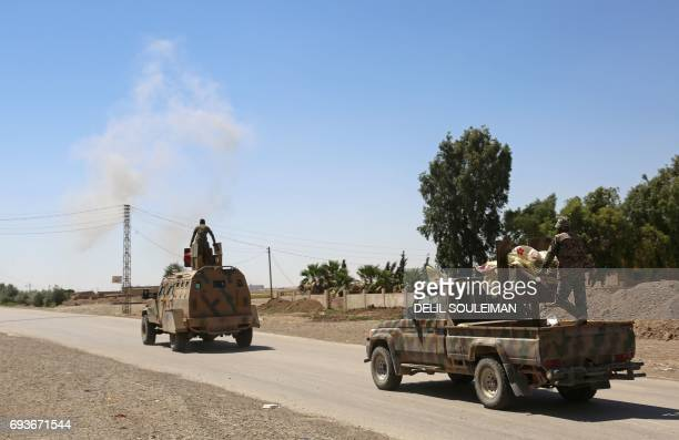 CORRECTION Syrian Democratic Forces made up of an alliance of Kurdish and Arab fighters drive two kilometres on the outskirts of an eastern entrance...