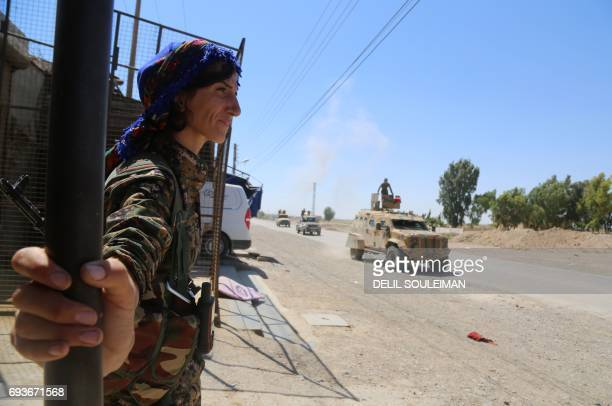 CORRECTION Syrian Democratic Forces made up of an alliance of Kurdish and Arab fighters drives some two kilometres on the outskirts of the AlMeshleb...