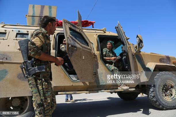 CORRECTION Syrian Democratic Forces made up of an alliance of Kurdish and Arab fighters stop two kilometres on the outskirts of an eastern entrance...