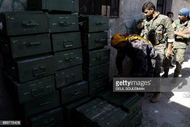 Syrian Democratic Forces made up of an alliance of Kurdish and Arab fighters unloaded boxes of ammunition supplied by the USled coalition in a...