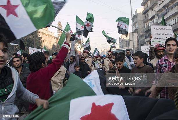 Syrian demonstrators rally in support of the Free Syrian Army calling for them to unite behind a unified command system in the northern Syrian city...