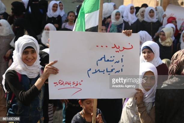 Syrian demonstrators to support Turkish soldiers' deployment on Idlib border as they hold a placard and Syrian flags in Idlib Syria on October 14...