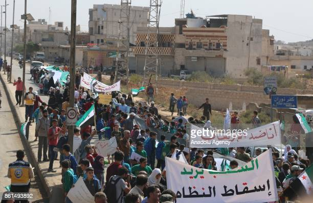 Syrian demonstrators to support Turkish soldiers' deployment on Idlib border as they hold Syrian flags in Idlib Syria on October 14 2017 Syrian...