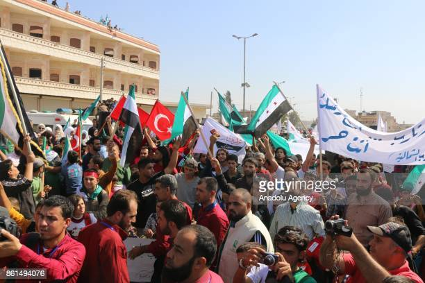 Syrian demonstrators to support Turkish soldiers' deployment on Idlib border as they hold Turkish and Syrian flags in Idlib Syria on October 14 2017...