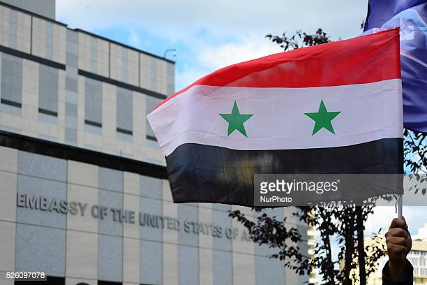 Syrian diaspora of Ukraine and activists from different political parties and NGOs of Ukraine protest in front of the US Embassy in Ukraine during...