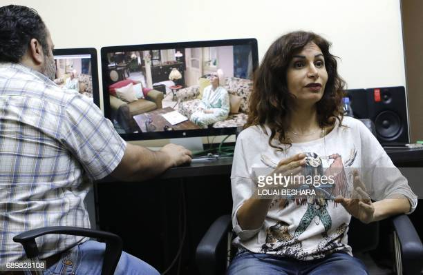 Syrian director Rasha Sharbatji talks about her television drama series 'Shoq' at an editing studio in Damascus on May 3 2017 Syria along with Egypt...