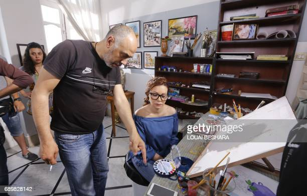 Syrian director Samir Hussein talks to Syrian actress Nadine Tahseen Beck during the filming of the serial drama 'Fouda' or 'Chaos' in the alQasaa...