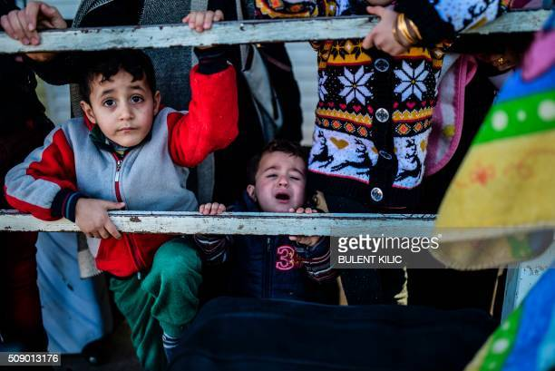 TOPSHOT Syrian families lineup waiting to go back to Syria on February 8 2016 at the Turkish Oncupinar border gate near Kilis southerncentral Turkey...
