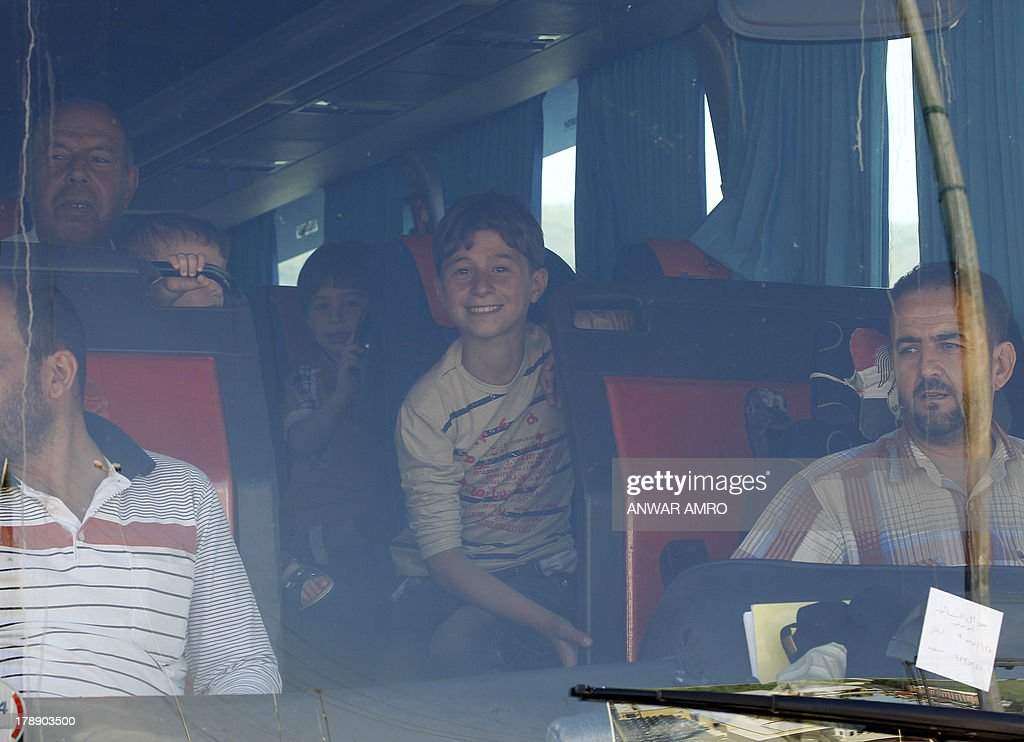 Syrian families sit inside a bus as they cross the Masnaa border post between Syria and Lebanon on August 31, 2013 in the Lebanese eastern Bekaa valley. As UN inspectors crossed the border from Syria into Lebanon, they were followed out of the war-torn country by a continuous flow of families desperate to flee the threat of US strikes. US President Barack Obama said that his administration was looking at the possibility of a 'limited, narrow act' over the suspected attack that reportedly killed hundreds, which Washington blames on the regime.