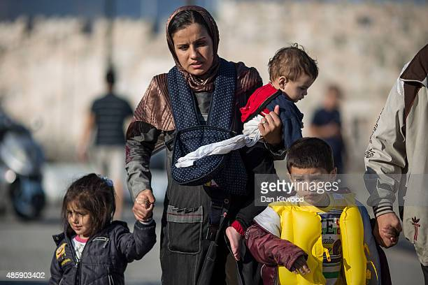 Syrian family arrive via the Greek coastguard at Kos ferry port after their crossing from Turkey on August 30 2015 in Kos Greece Migrants from many...
