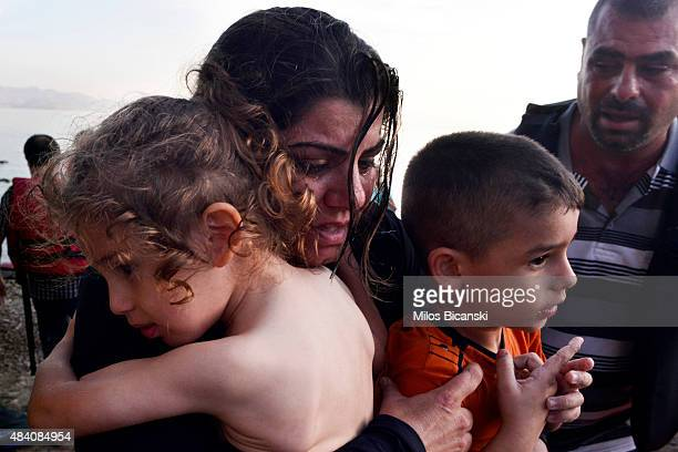 Syrian family arrives at a beach on the Greek island of Kos after crossing a part of the Aegean sea from Turkey to Greece in a dinghy on August 15...