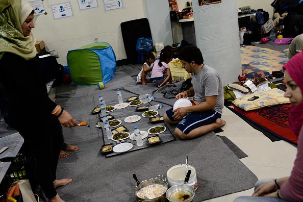 A Syrian family prepares an iftar dinner in Piraeus port...