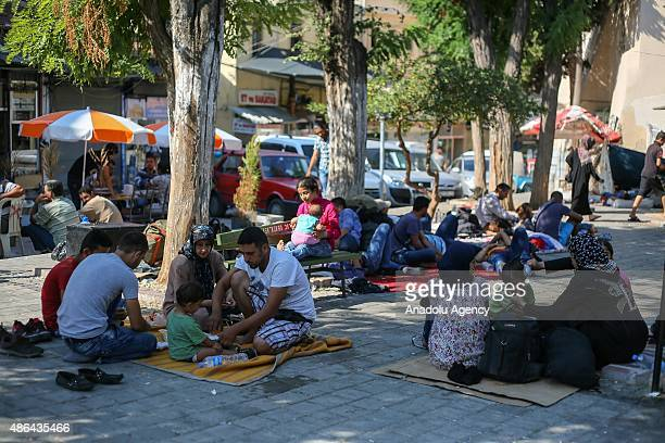 Syrian family who escaped from Syria sit at a park as they have their lunch in Izmir Turkey on September 3 2015 Syrians who came to Turkey's Izmir...