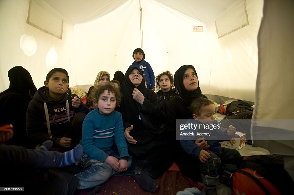 A Syrian family who fled bombing in Aleppo, is seen in a tent, which was distributed by the IHH Humanitarian Relief Foundation, a Turkish NGO, at the Oncupinar crossing, opposite the Turkish province of Kilis, near Azaz town of Aleppo, Syria on February 6, 2016. Thousands of Syrians have massed on the Syrian side of the border seeking refuge in Turkey.