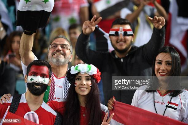 Syrian fans cheer for their team prior to the 2018 World Cup football qualifying match between Australia and Syria in Sydney on October 10 2017 / AFP...