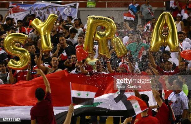 Syrian fans cheer prior to the 2018 FIFA World Cup Asian Playoff match between Syria and the Australia Socceroos at Hang Jebat Stadium on October 5...