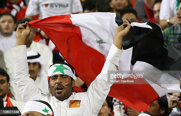 Syrian fans cheer prior to the AFC Asian Cup Group B match between Syria and Japan at Qatar Sports Club Stadium on January 13 2011 in Doha Qatar