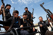 Syrian fighters from a group calling themselves 'The right bombs squad' many of who left their studies and jobs to join rebels hold their weapons at...