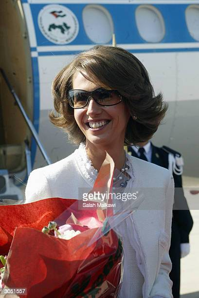 Syrian First Lady Asma AlAssad wife of President Bashar alAssad smiles upon her arrival at Beirut international airport March 07 2004 Arab first...