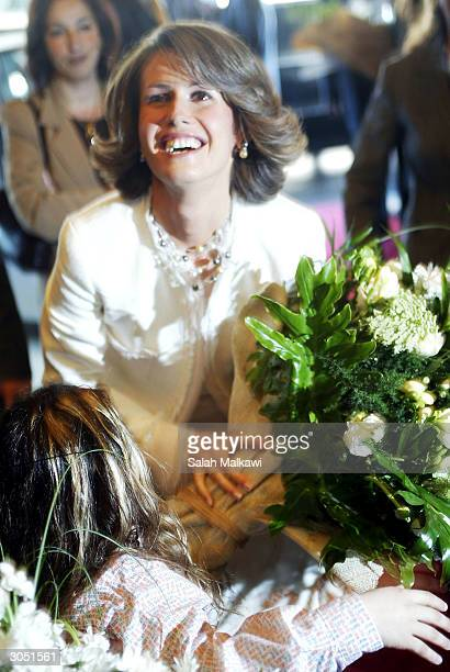 Syrian First Lady Asma AlAssad wife of President Bashar alAssad smiles upon her arrival in Beirut March 07 2004 Arab first ladies are gathering in...