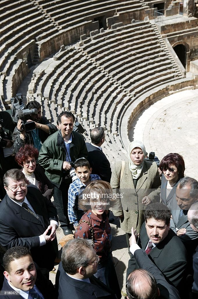 Syrian first lady Asmaa Al Assad (C) tours the ancient ruins of Bosra March 31, 2004 which is an old Roman city in the south of Syria. Al Assad is promoting the United Nations Developing Program (UNDP) which is a program dedicated to distributing information technology (IT) throughout the local rural areas of Syria.