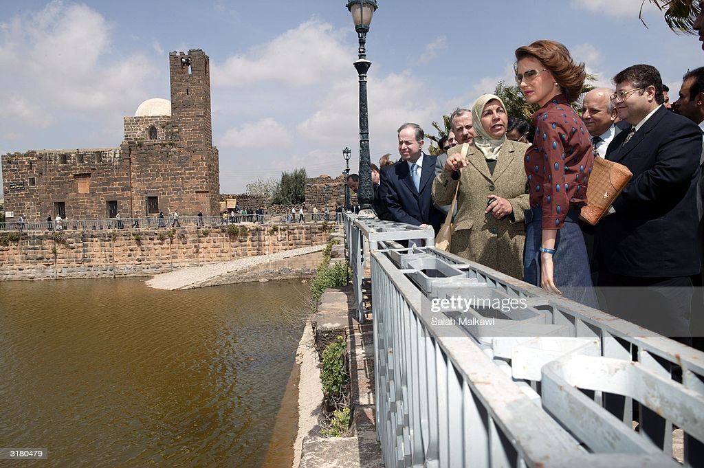 Syrian first lady Asmaa Al Assad (2nd-R) walks March 31, 2004 at the ancient ruins of Bosra, an ancient Roman city in the south of Syria. Al Assad is promoting the United Nations Developing Program (UNDP) which is a program dedicated to distributing information technology (IT) throughout the local rural areas of Syria.