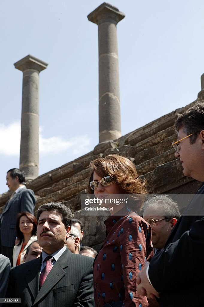Syrian first lady Asmaa Al Assad (C) walks through the ancient ruins of Bosra, an old Roman city in the south of Syria. Al Assad is promoting the United Nations Developing Program (UNDP) which is a program dedicated to distributing information technology (IT) throughout the local rural areas of Syria.