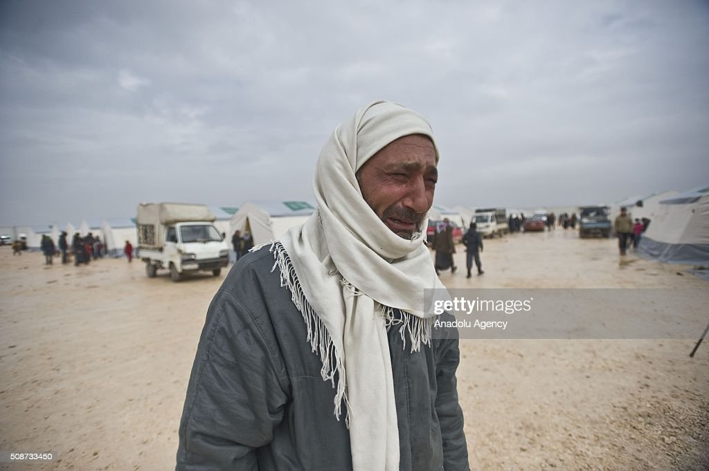 A Syrian, fled from his home due to Russian and Assad Regime forces attacks, cries on the way between Aleppo and Azez in Syria on February 6, 2016.