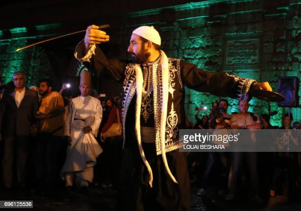 A Syrian folklore band perform during a ceremony organized by the Syrian Ministry of Tourism during for the Muslim holy month of Ramadan outside the...