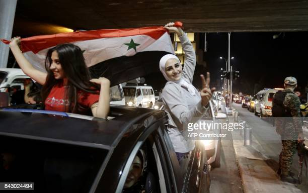 Syrian football fans celebrate in the streets of Damascus after the FIFA World Cup 2018 qualification football match between Iran and Syria ended in...