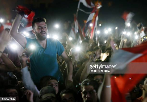 Syrian football fans watch in Damascus the FIFA World Cup 2018 qualification football match between Iran and Syria played in Iran on September 5 2017...